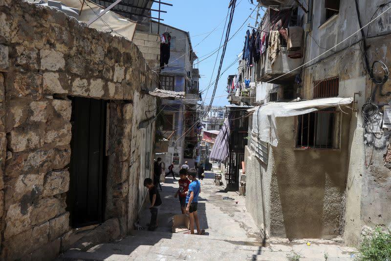 Boys play along an alleyway in Tripoli