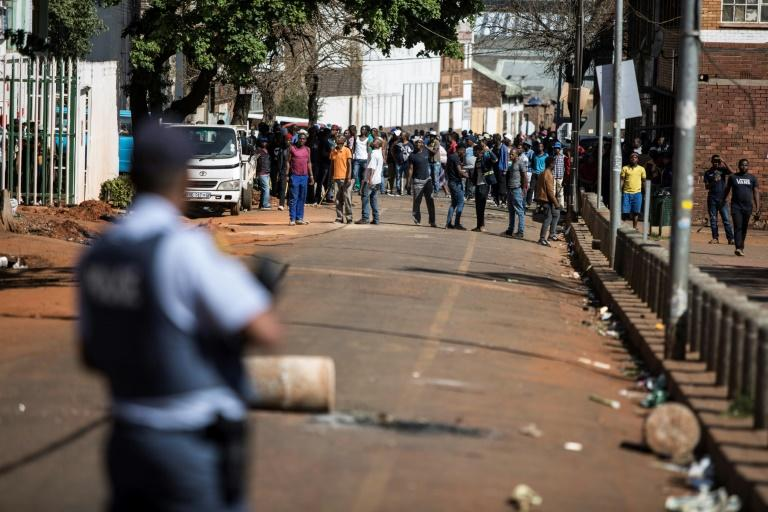 Gangs of aggressors armed with sticks and machetes attacked businesses in South Africa's financial capital last month during deadly xenophobic attacks (AFP Photo/GUILLEM SARTORIO)