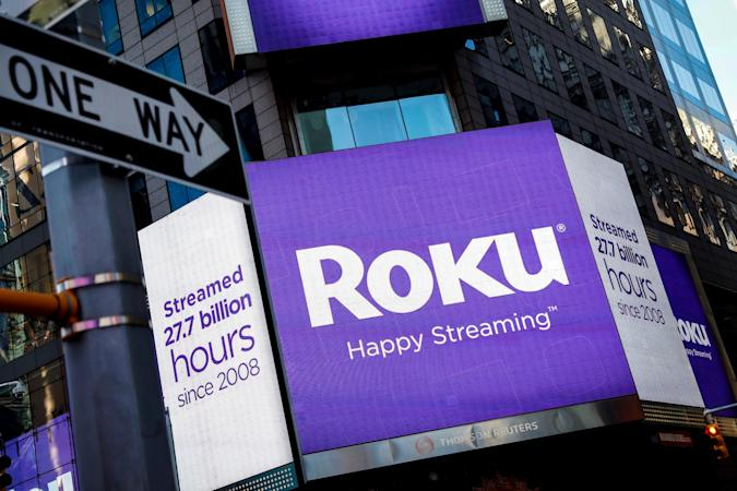 FILE PHOTO A video sign displays the logo for Roku Inc, a Fox-backed video streaming firm, in Times Square after the company's IPO at the Nasdaq Market in New York, U.S., September 28, 2017. REUTERS/Brendan McDermid/File Photo GLOBAL BUSINESS WEEK AHEAD
