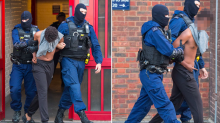 Police arrest 14 people in dawn raid crackdown on violent drug-dealing network