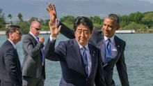 Japan's Prime Minister Abe visits Pearl Harbor memorial on Hawaii trip