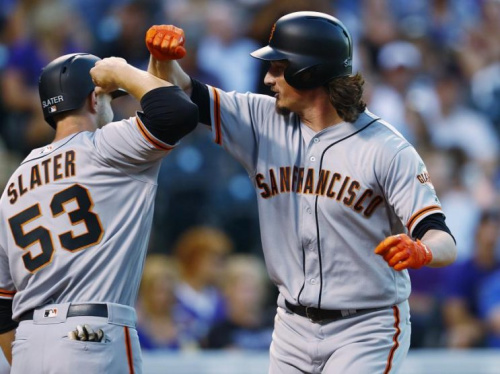 Jeff Samardzija (right) bashes forearms with teammate Austin Slater after his impressive home run. (AP)