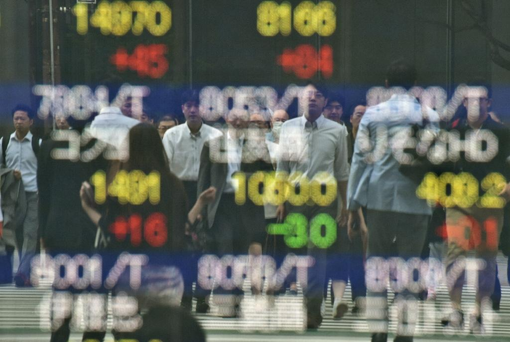 As the shock results of the UK referendum rolled in on June 24, 2016, equity markets in Asia went into meltdown, wiping hundreds of billions of dollars off shares (AFP Photo/Kazuhiro Nogi)