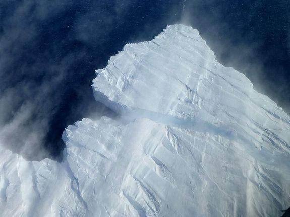 An iceberg breaks off Pine Island Glacier into the Amundsen Sea in West Antarctica.