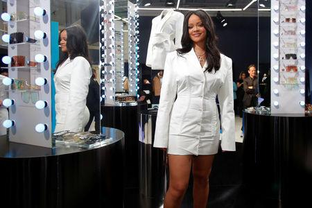 76f22753f18062 Pop superstar Rihanna poses in a pop-up store to present her first  collection with