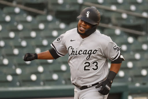 Chicago White Sox's Edwin Encarnacion celebrates his solo home run against the Detroit Tigers in the fourth inning of a baseball game in Detroit, Tuesday, Aug. 11, 2020. (AP Photo/Paul Sancya)