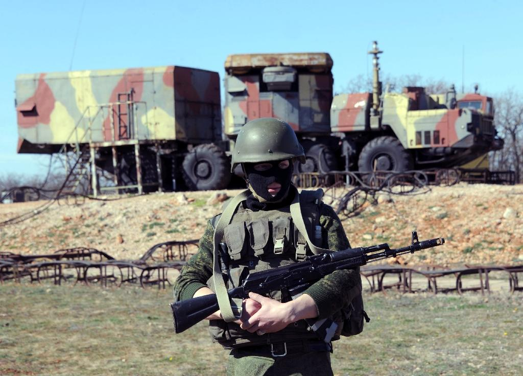 A Russian soldier stands guard in front of an S300 surface-to-air missile battery like those delivered to Syria after a September Israeli strike during which a Russian aircraft was accidentally downed
