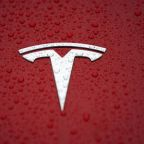 Tesla promises return to profit in third quarter after large loss, may raise more capital
