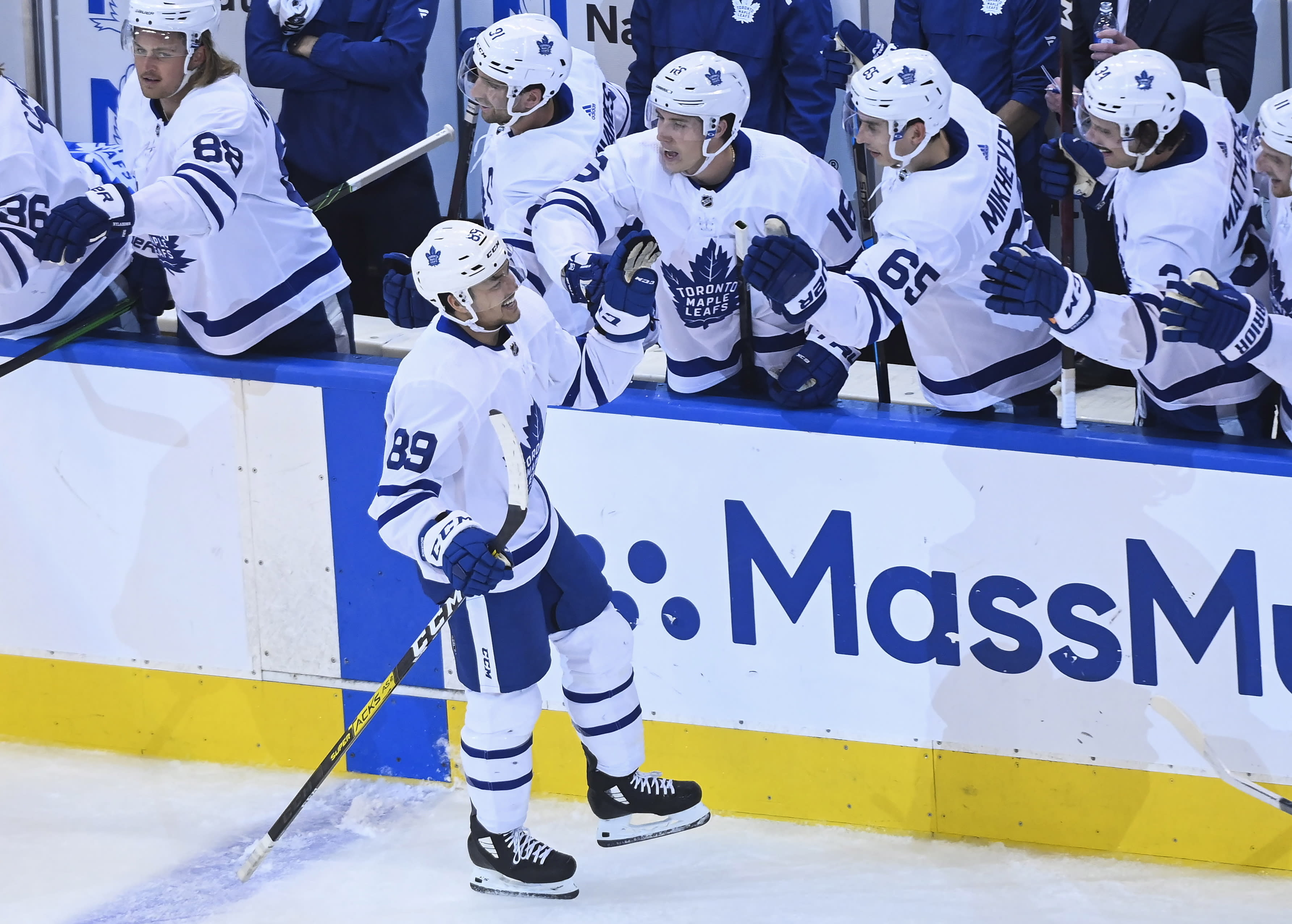 Toronto Maple Leafs left wing Nicholas Robertson (89) celebrates his first NHL goal with teammates during the second period of an NHL hockey playoff game against the Columbus Blue Jackets Thursday, Aug. 6, 2020, in Toronto. (Nathan Denette/The Canadian Press via AP)