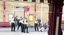 Dramatic footage shows moment police taser knife-wielding man on train station platform