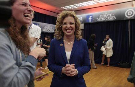 Debbie Wasserman Schultz, Chair of the Democratic National Committee, speaks with journalists in the spin room after the Democratic U.S. presidential candidates debate sponsored by Univision at the Miami Dade College in Kendall