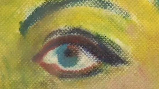 Artist exhibits paintings on paper towels