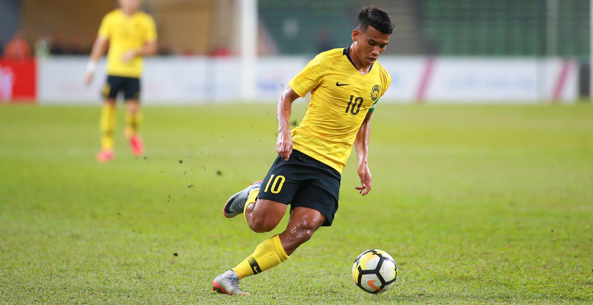 Malaysia slogged to a narrow win over Laos