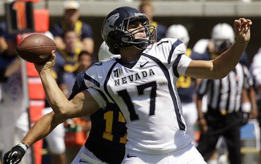 Nevada quarterback Cody Fajardo (17) drops back to pass against California during the first half of an NCAA college football game, Saturday, Sept. 1, 2012, in Berkeley, Calif. (AP Photo/Ben Margot)