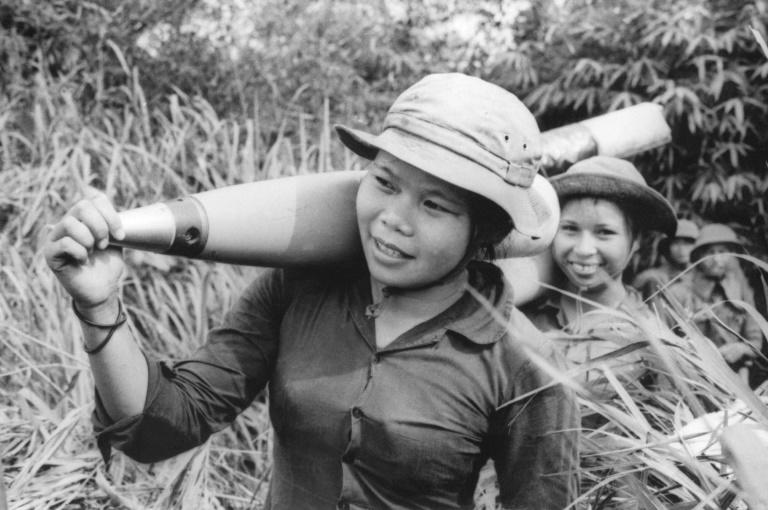 "Picture released 10 June 1972 by North Vietnamese official agency with a caption saying: ""Young women carry the ammunition to the front in Quang Tri province, south Vietnam"" (AFP Photo/VAN BANG)"