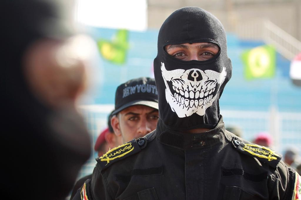 Fighters from the Iraqi Imam Ali Brigade take part in a military parade on August 8, 2015 in the mostly Shiite holy city of Najaf