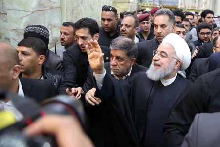 Iranian President Hassan Rouhani waves to the people at the Imam Ali shrine in Najaf, Iraq March 13, 2019. Official Iranian President website/Handout via REUTERS