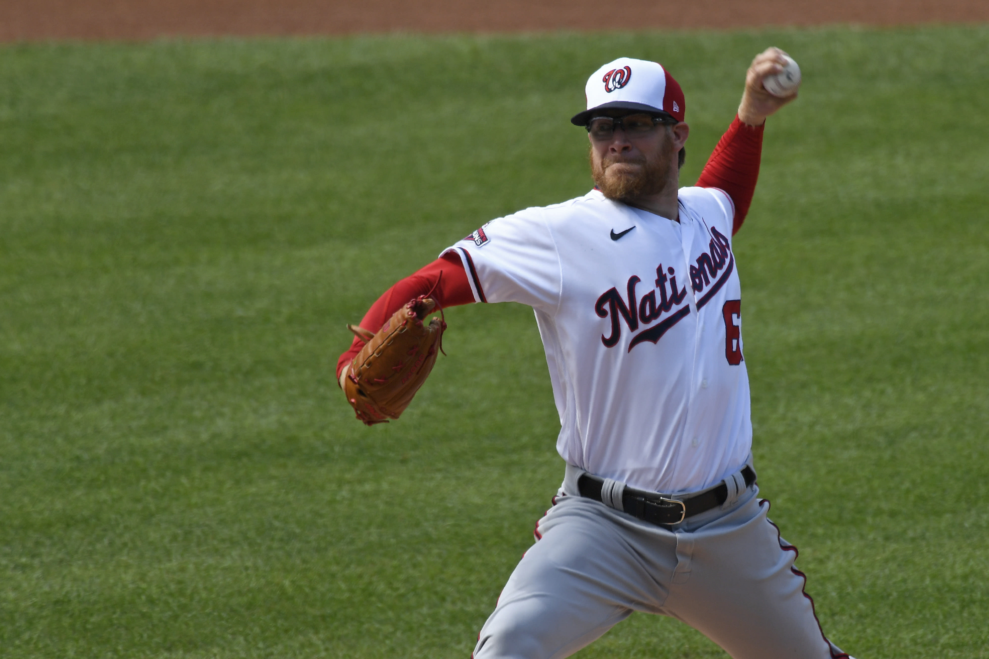 Washington Nationals pitcher Sean Doolittle delivers a pitch during an intersquad baseball game at Nationals Park in Washington, Friday, July 17, 2020. (AP Photo/Susan Walsh)