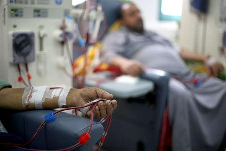 A Palestinian patient sleeps as he undergoes kidney dialysis at Shifa hospital in Gaza City. REUTERS/Mohammed Salem