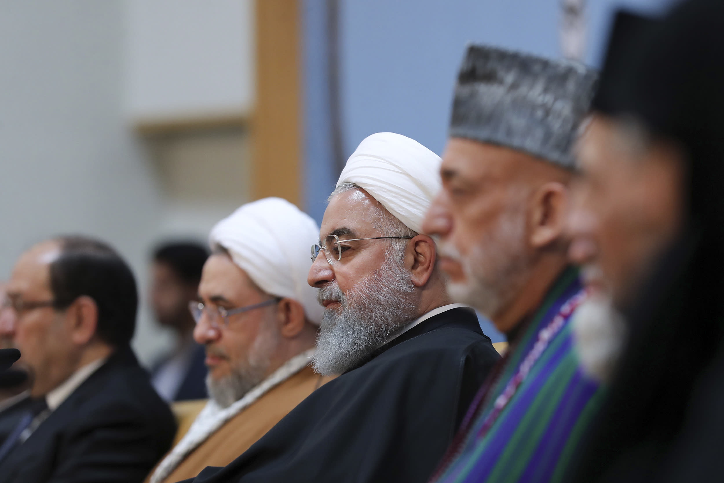 """In this photo released by official website of the office of the Iranian Presidency, President Hassan Rouhani, center, attends an annual Islamic Unity Conference in Tehran, Iran, Saturday, Nov. 24, 2018. Rouhani has called Israel a """"cancerous tumor"""" established by Western countries to advance their interests in the Middle East. (Iranian Presidency Office via AP)"""