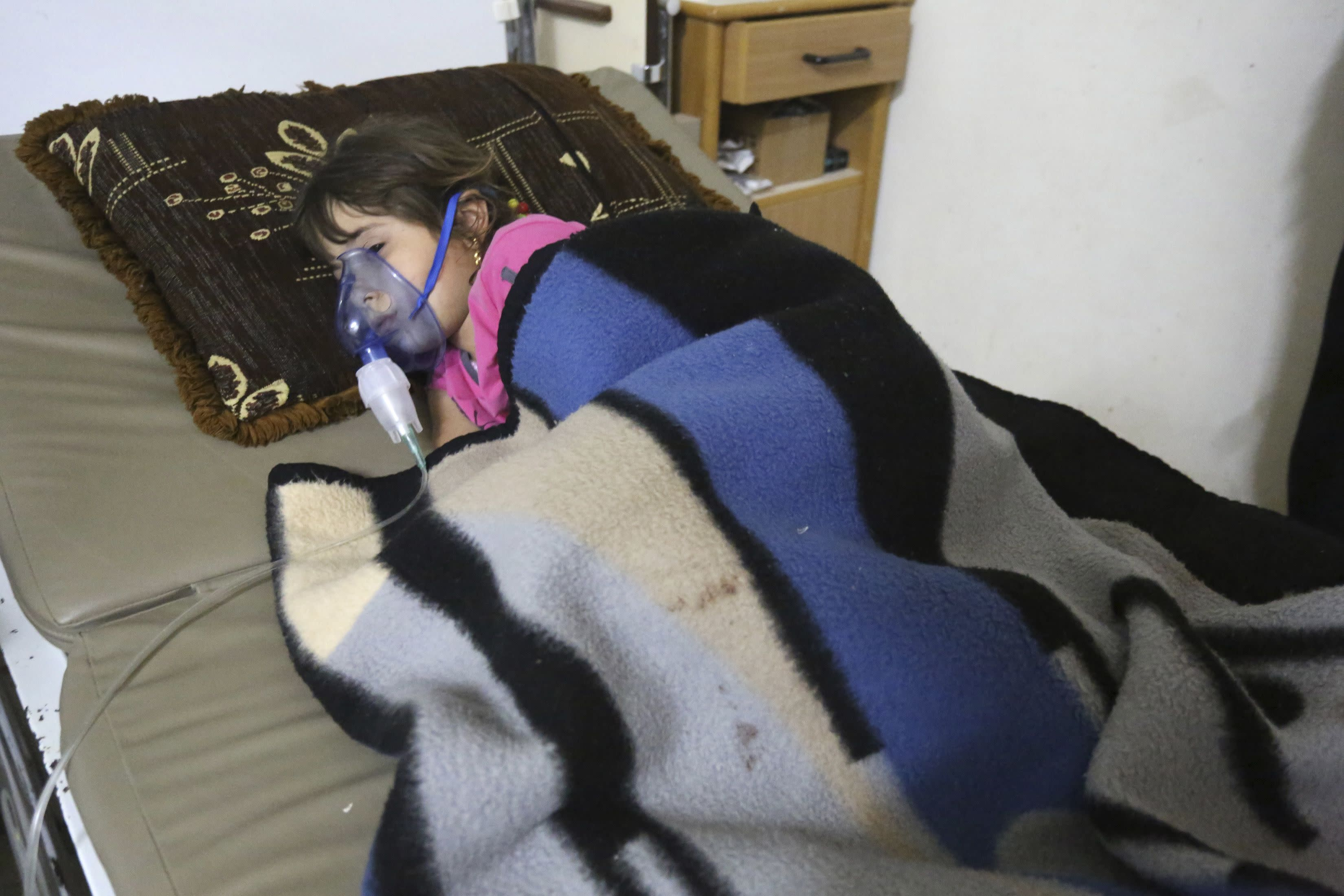 A girl, affected by what activists say was a gas attack, receives treatment inside a makeshift hospital in Kfar Zeita village in the central province of Hama May 22, 2014. Syrian opposition activists have posted a video of what they say is chlorine gas floating through the streets of the village, the first such footage of an alleged chemical weapon campaign by President Bashar al-Assad. The village of Kfar Zeita, in the central province of Hama 125 miles (200 km) north of Damascus, has been the epicentre of what activists and medics say is two-month-long assault in which chlorine gas canisters are dropped out of helicopters. Picture taken May 22. To match story SYRIA-CRISIS/CHLORINE REUTERS/Badi Khlif (SYRIA - Tags: POLITICS CIVIL UNREST CONFLICT HEALTH TPX IMAGES OF THE DAY)