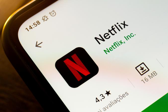 In this photo illustration a Netflix app seen displayed on a...