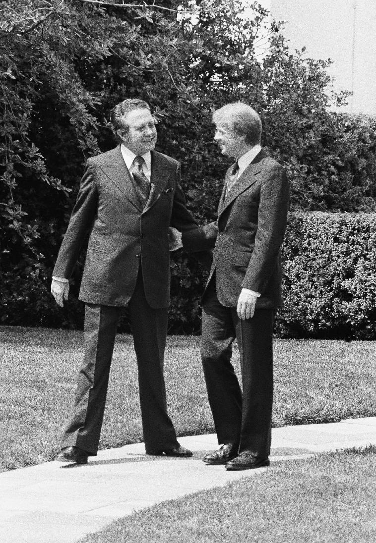 FILE - In this April 21, 1977 file photo, Pres. Jimmy Carter, right, bids goodbye to Portuguese Prime Minister Mario Soares, left, outside the Oval Office of the White House in Washington, D.C. Portugal's Socialist Party, which Soares once led, said he died Saturday, Jan. 7 2017, at the age of 92. Soares had been hospitalized seen Dec. 13 2016. (AP Photo/Charles Bennett, file)