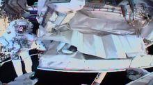 Spacewalking astronauts plug leak, finish fixing detector