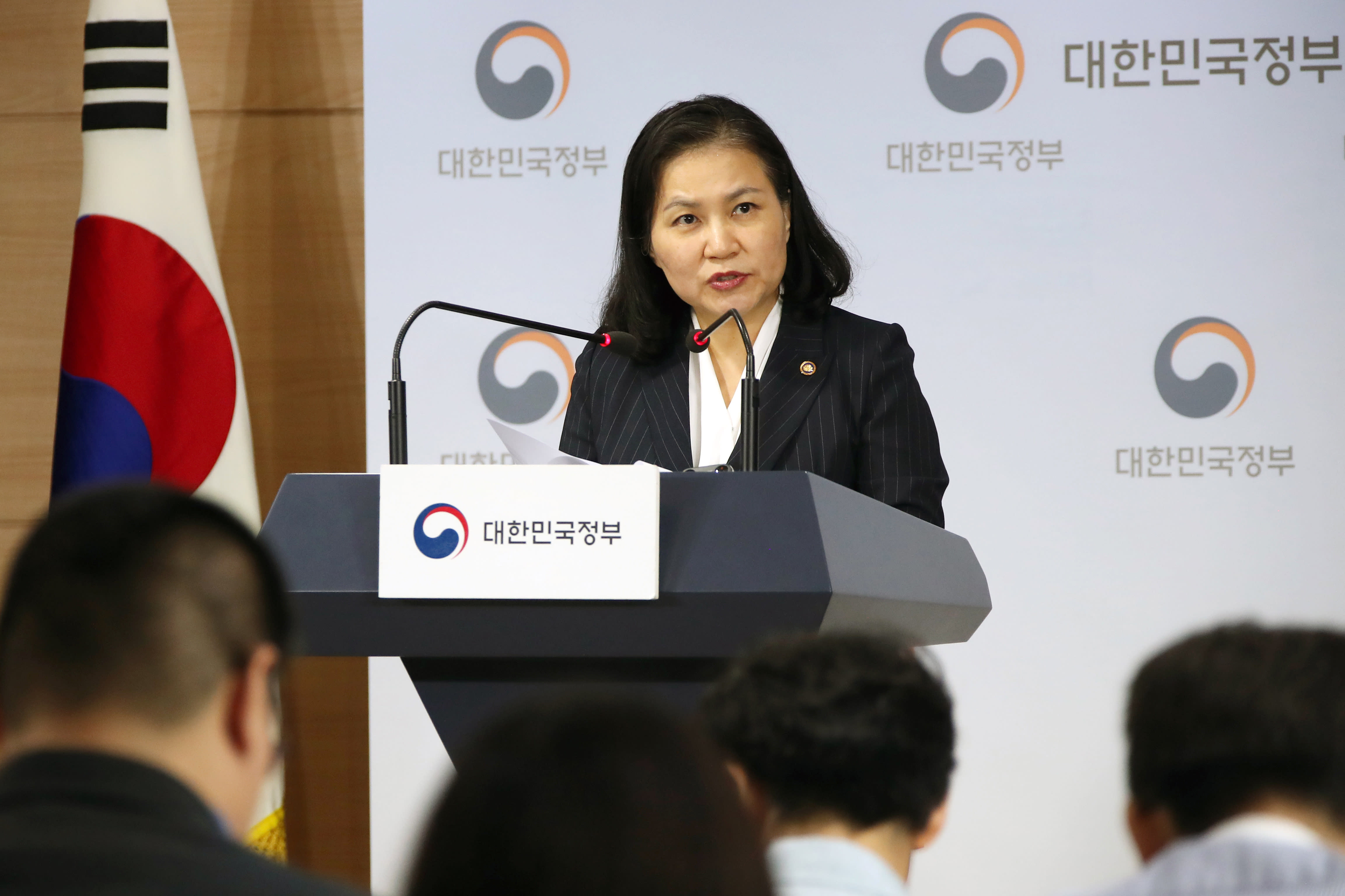South Korea's senior trade official Yoo Myung-hee speaks during a briefing at a government complex in downtown Seoul, South Korea, Wednesday, Sept. 11, 2019. South Korea is filing a complaint with the World Trade Organization over Japan's tightened export controls on key materials South Korean companies use to make computer chips and displays, accusing Tokyo of weaponizing trade to retaliate over political rows. (Kim Seung-doo/Yonhap via AP)
