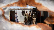 South Africa struggles with lockdown as it records first coronavirus death