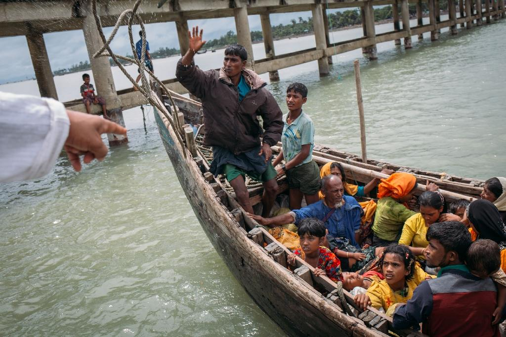 Bangladeshi boat owners were charging refugees up to $100 for a 10-30 minute trip to Bangladesh that would normally cost less than 50 US cents (AFP Photo/Adib Chowdhury)