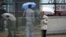 Global stocks rise as finance leaders back easy money