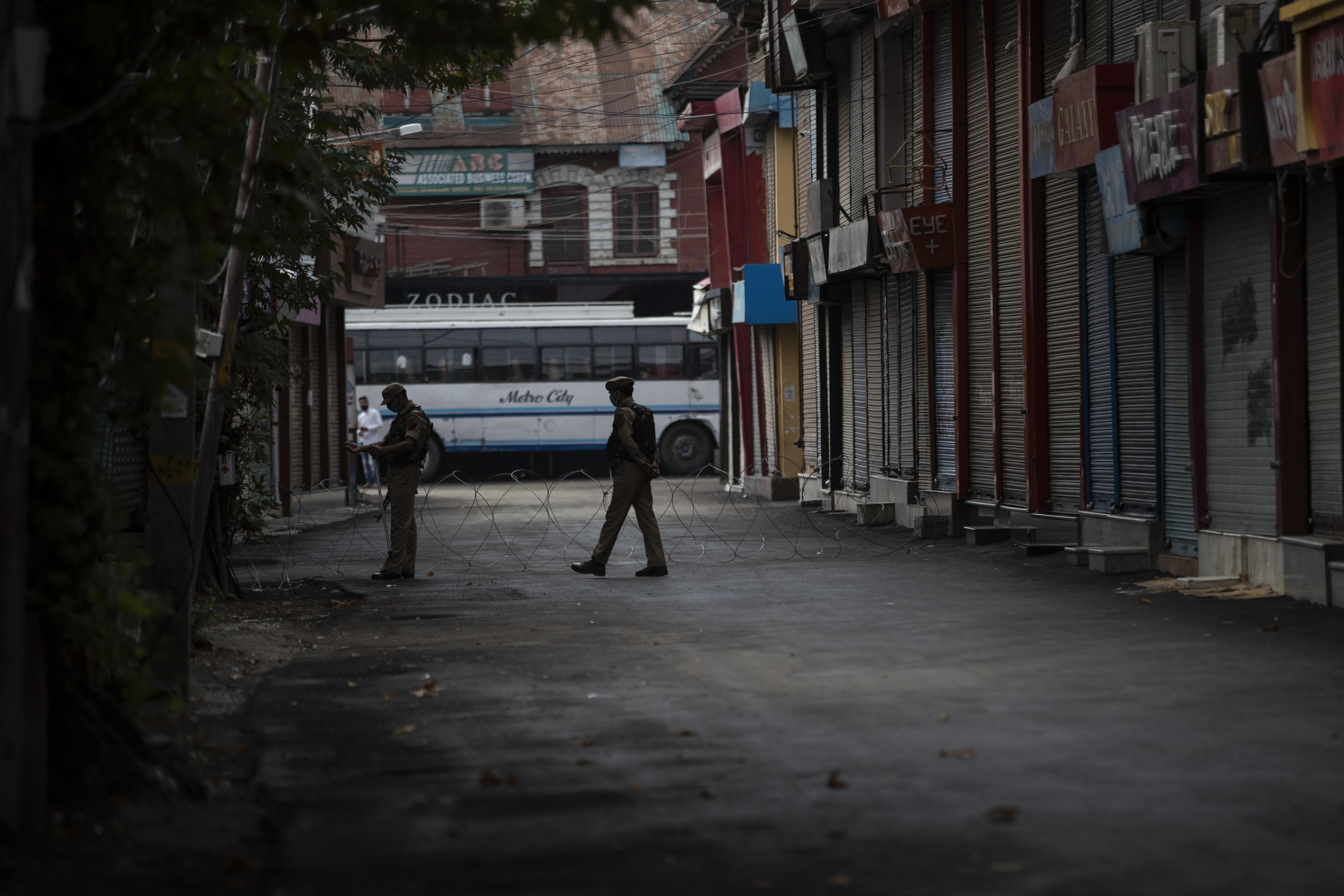 Indian paramilitary soldiers keep guard during restrictions in Srinagar, Indian controlled Kashmir, Friday, Aug. 28, 2020. Police and paramilitary soldiers on Friday detained dozens of Muslims participating in religious processions in the Indian portion of Kashmir. Authorities had imposed restrictions in parts of Srinagar, the region's main city, to prevent gatherings marking Muharram from developing into anti-India protests. (AP Photo/Mukhtar Khan)