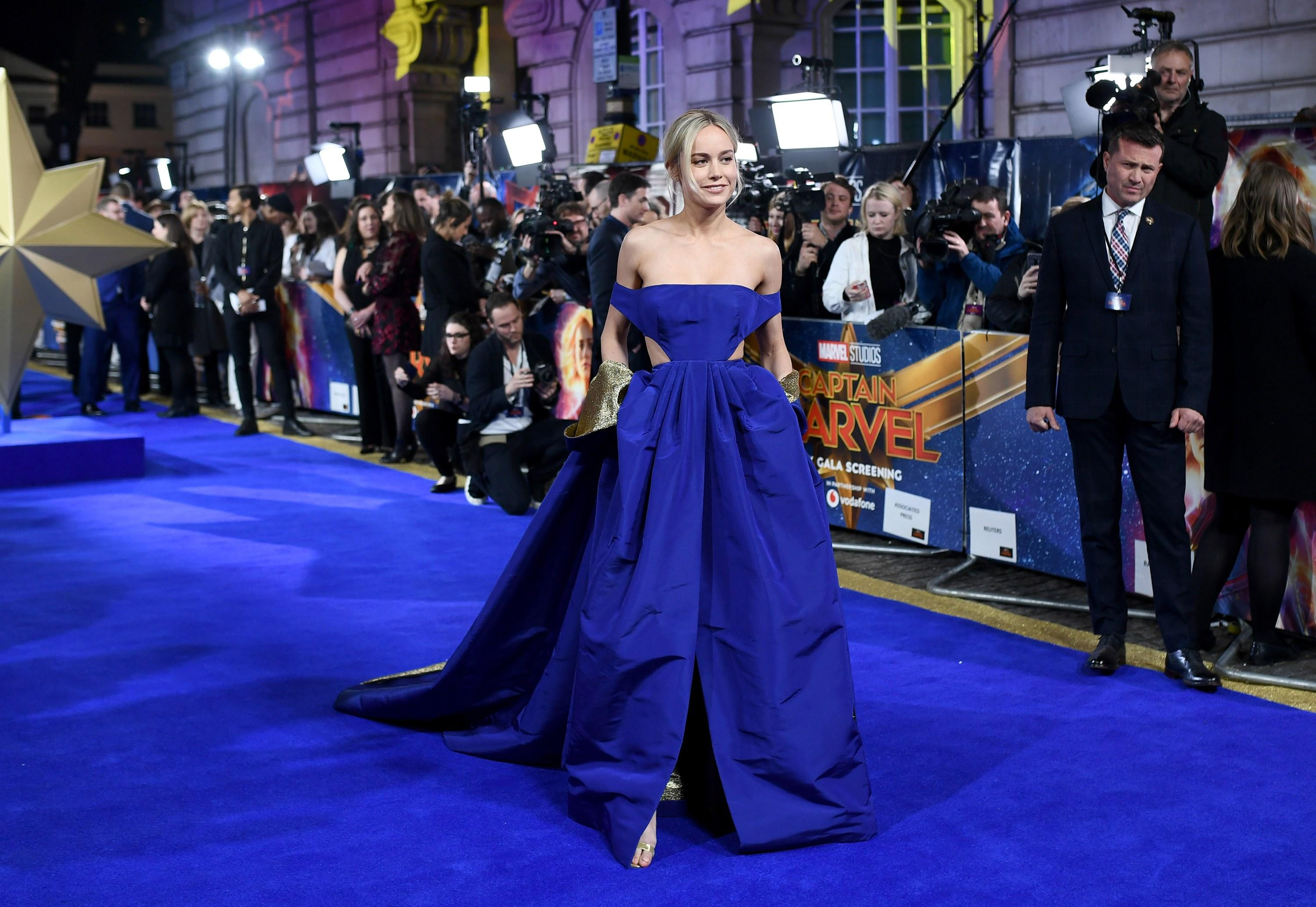 brie larson attends the captain marvel premiere dressed as a real