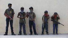Mexican villages arm children in desperate bid for attention