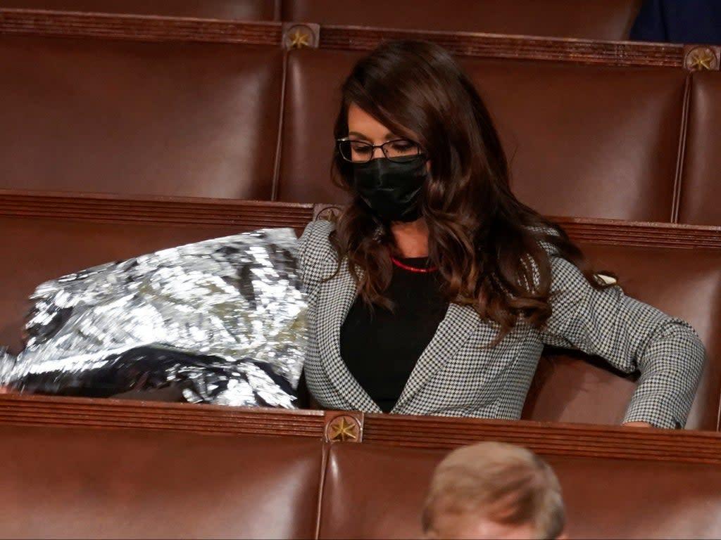 Lauren Boebert makes 'space blanket' protest at Biden's..