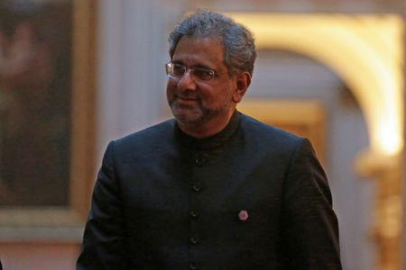 FILE PHOTO: Pakistan's Prime Minister Shahid Khaqan Abbasi arrives to attend The Queen's Dinner during The Commonwealth Heads of Government Meeting (CHOGM), at Buckingham Palace in London on April 19, 2018. Daniel Leal-Olivas/Pool via Reuters