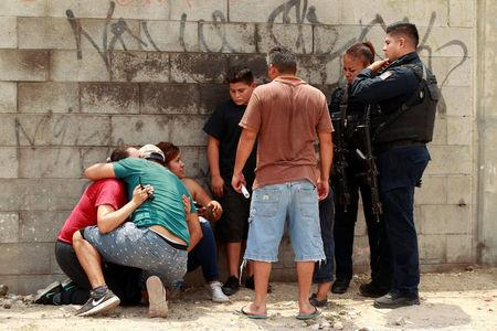 Eleven found killed in Mexico border town ahead of president