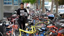 China seeks safe steering of bike-sharing boom to clear cluttered streets