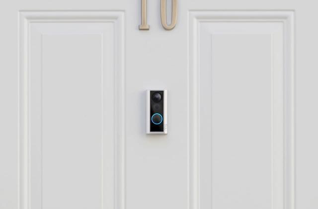 Ring's newest doorbell sits over your door's peephole