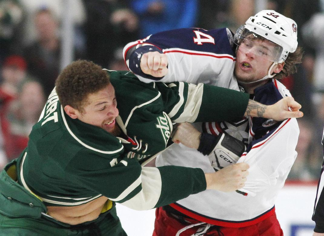 Minnesota Wild right wing Chris Stewart (7) and Columbus Blue Jackets right wing Josh Anderson (34) fight during the second period of an NHL hockey game Saturday, Dec. 31, 2016, in St. Paul, Minn. (AP Photo/Andy Clayton-King)