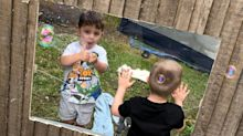 Mum builds window into garden fence so toddler pals can play together