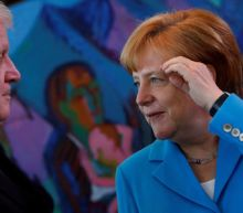 Defiant Merkel backs Europe migrant policy as Bavaria row simmers
