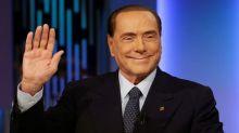 Italy's Berlusconi regales fans a week ahead of vote