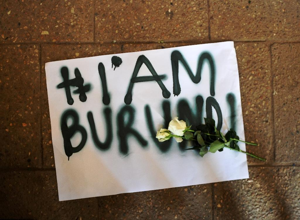 "A placard reading ""I am Burundi"" lies on the ground during a protest in the Kenyan capital Nairobi on December 18, 2015 against recent killings in Burundi by government forces (AFP Photo/Tony Karumba)"