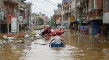 Sleepless nights on China's dykes as floods hit 34 million people