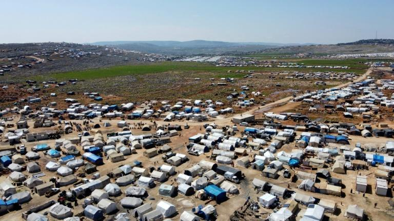 Aid workers fear that sprawling, densely populated tent cities like Kfar Lusin could nurture an explosion of coronavirus infection (AFP Photo/AAREF WATAD)