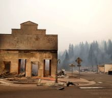 Wildfire leaves historic, 'quirky' California town in smoldering ruins