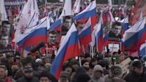 Russians march in solidarity with slain Putin political foe