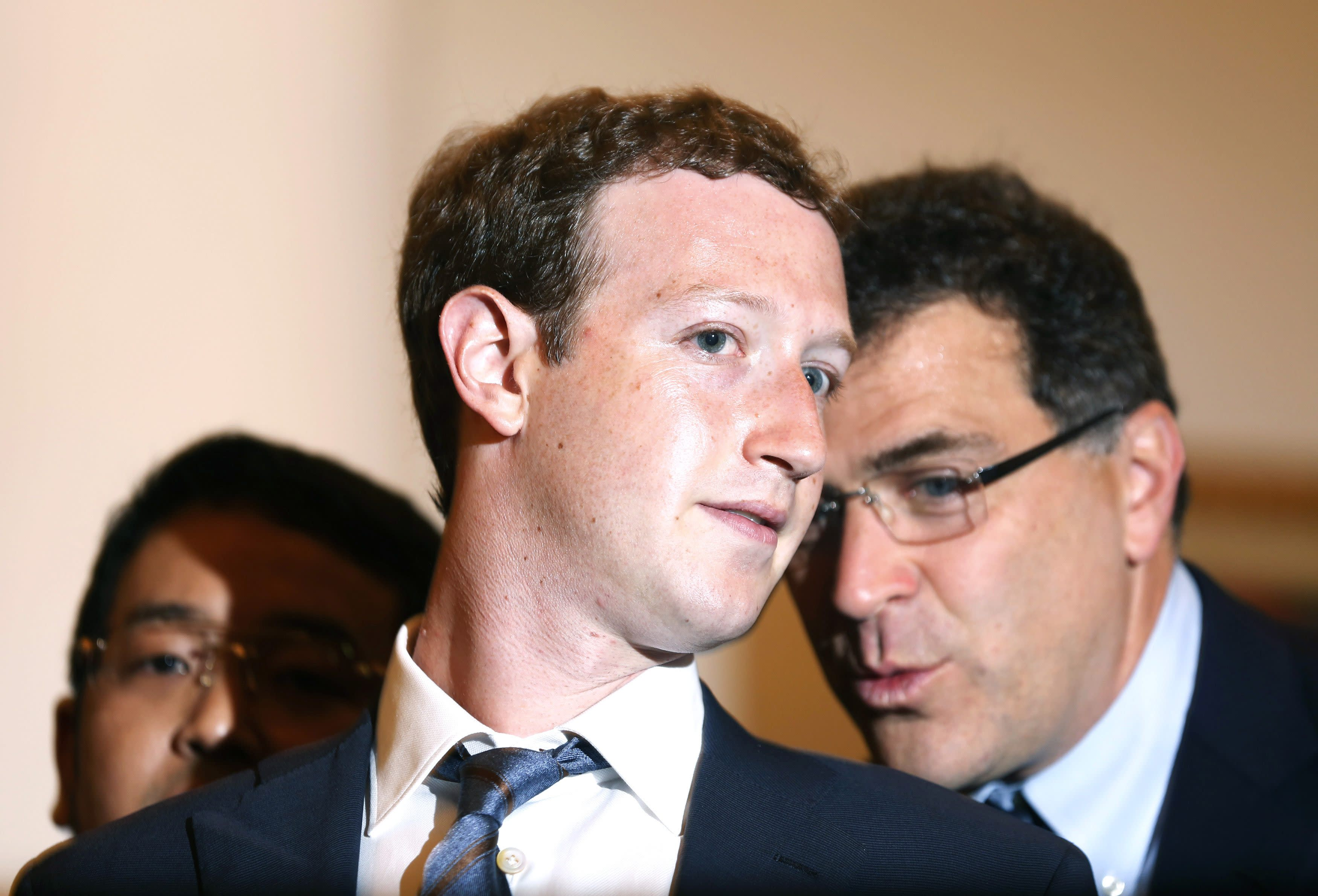 Mark Zuckerberg, founder and CEO of Facebook, talks to his colleagues at Jakarta city hall